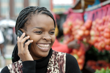 African or black American woman calling on mobile cellphone