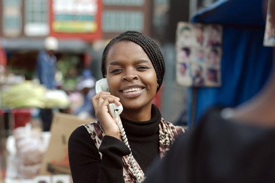 African or black American woman calling on landline telephone