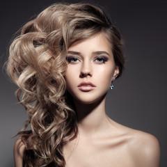 Wall Mural - Beautiful Blond Woman. Curly Long Hair