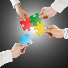 Team work concept, Hands hold puzzles connect each other with gr