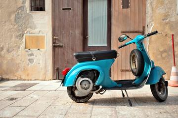 Fotorolgordijn Scooter Vintage italian scooter Vespa on old medieval street