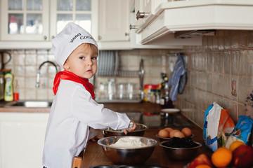 Boy, baking muffins