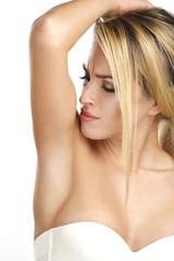 beautiful woman applying roll deodorant