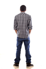 rear view of young black man with his hands in his pockets
