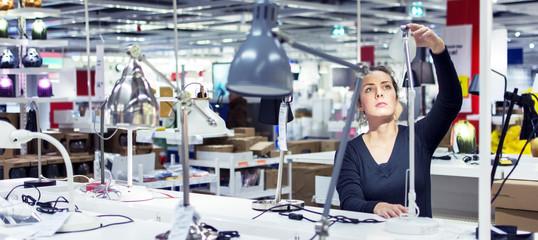 Women shopping indoors for interior lighting