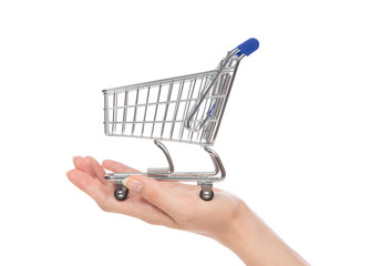 Hands hold empty shopping cart for sale