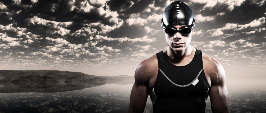 Swimmer triathlon man with cap and glasses outdoor at rough sea