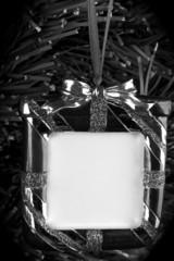 Black and white,hanging photo frame on christmas tree background