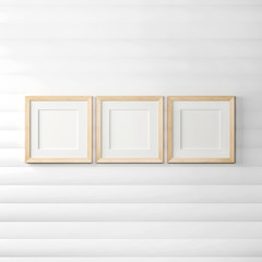 Wooden frames on a white wooden background