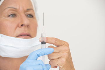 Nurse with Flu vaccination in injection