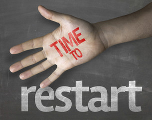 "Creative composition with the message ""Time to Restart"""