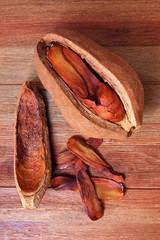 mahogany seed on wood table,