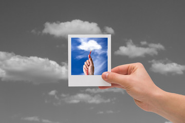 Holding Instant photo. Cloud computing concepts.
