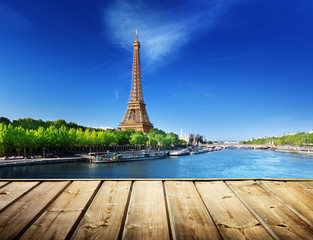 Photo Stands Paris background with wooden deck table and Eiffel tower in Paris