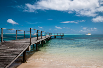 Overwater wooden path inside lagoon in french polynesia