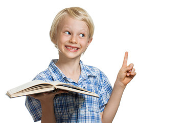 Young boy holding book and pointing