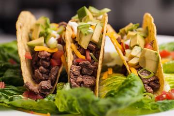 Trio of roast beef hard-shell tacos