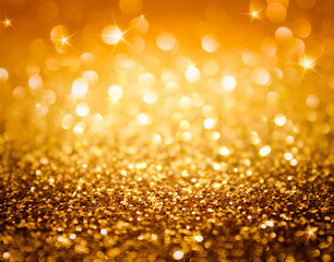 golden glitter and stars for christmas background