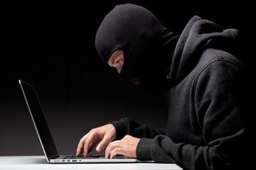 Fototapeta Computer hacker in a balaclava