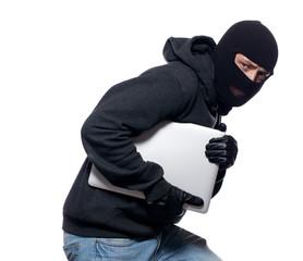 Thief stealing a laptop computer - fototapety na wymiar