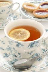 Earl Grey tea in floral bone china and a slice of lemon