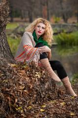 Beautiful woman posing in park during autumn season