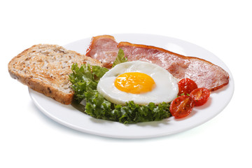 Fried eggs with tomato, ham and bread isolated