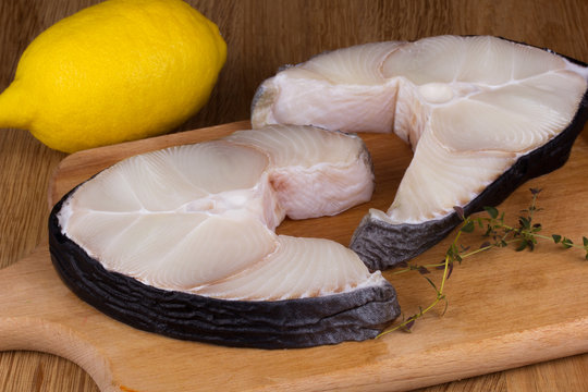shark steak with lemon on a chopping board