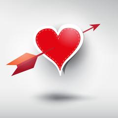 Vector red heart pierced with an arrow