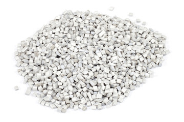 grey plastic polymer granules on white background