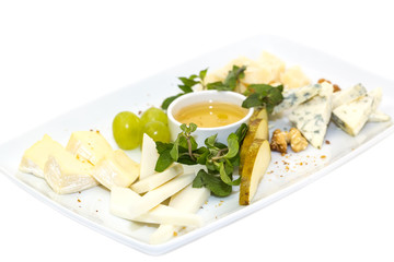 cheese plate, with several kinds of cheese on a white background