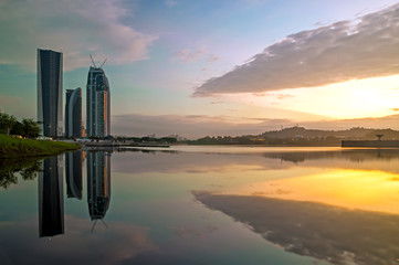 Sunrise of buildings in Putrajaya, Malaysia by the lakeside