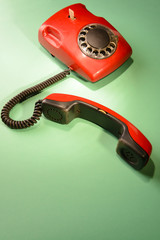Red retro telephone,on color background