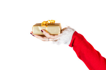 An image of Santa's hand holding a gift box