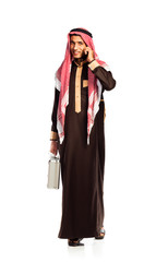 Young smiling arab with a aluminum case and cellphone isolated o