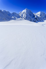 Fototapete - Winter mountains -  snow-capped peaks of the Alps