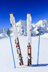 Fototapete - Ski, winter season , mountains and ski equipments