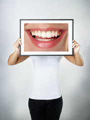 Woman holding picture with a big smile