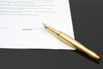 signing contract with fountain pen
