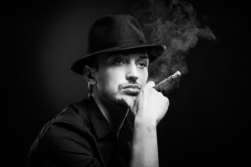 Fototapeta Gangster look. Man with hat and cigar.