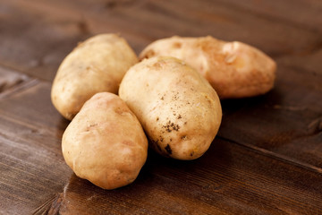 Homegrown potatoes on vintage table