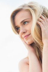 Wall Mural - Close up of a smiling relaxed blond looking away