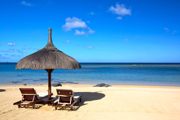 Wall Mural - Tropical beach with chairs and umbrella in Mauritius
