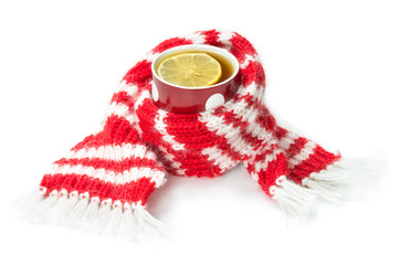 wool scarf, wrapped around a cup of tea