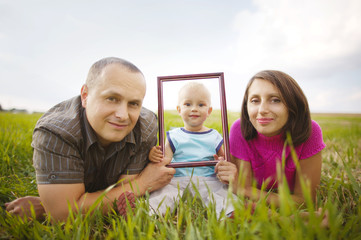 Smiling family through empty frame