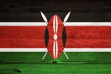 Kenya Flag painted on old wood plank background.