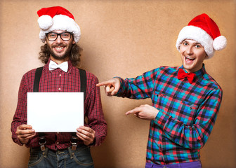 Photo of two men in clothes of Santa Claus