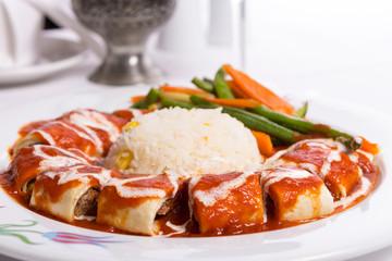 Turkish Beyti Kebap Garnished with Vegetables