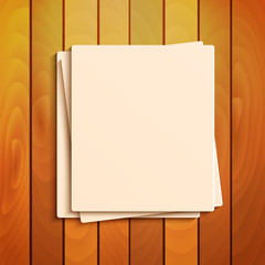 blank sheets of paper on the background a wooden surface.station