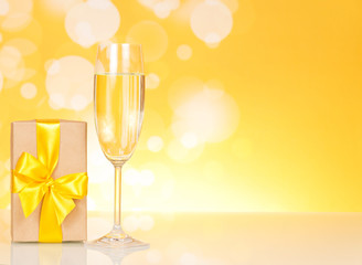 Glass of champagne and gift